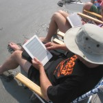 David enjoys using his kindle at the beach to read and order new books