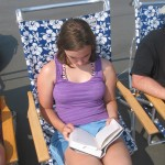 Sarah uses a traditional book form at the beach